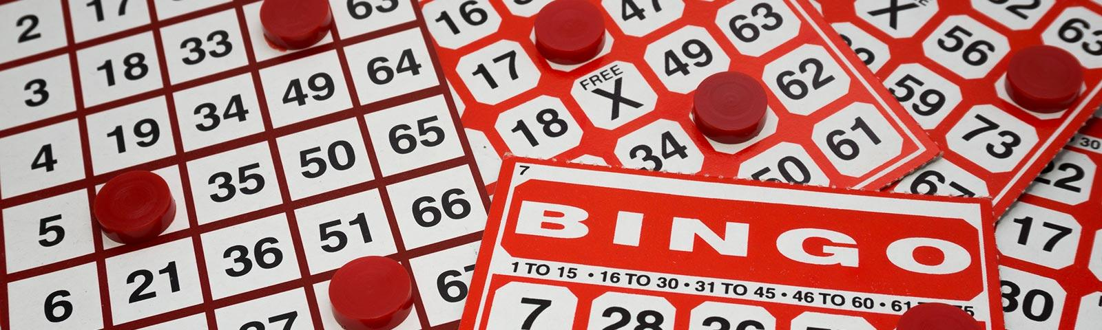 Close up on a bunch of bingo cards.