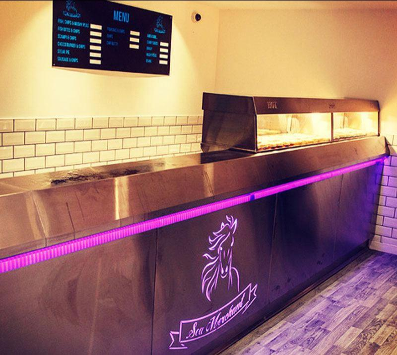 A fish & chip shop counter.