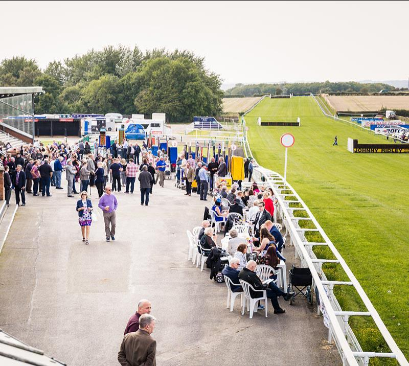 Crowds attending racing at Sedgefield Racecourse.