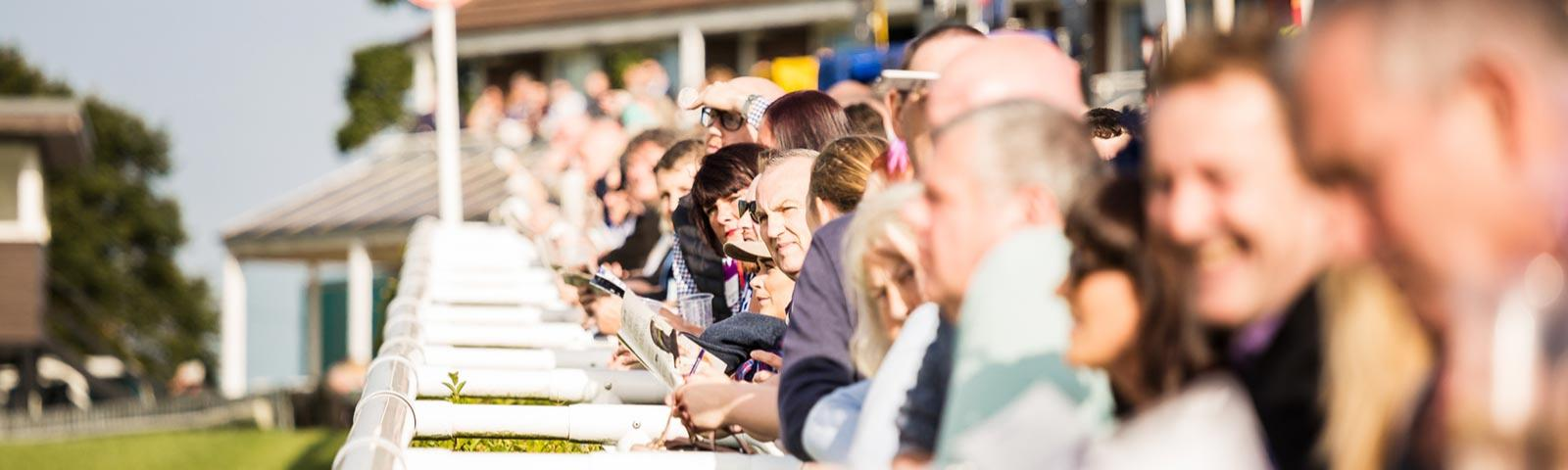 Racegoers lined up next to the track at Sedgefield Racecourse.